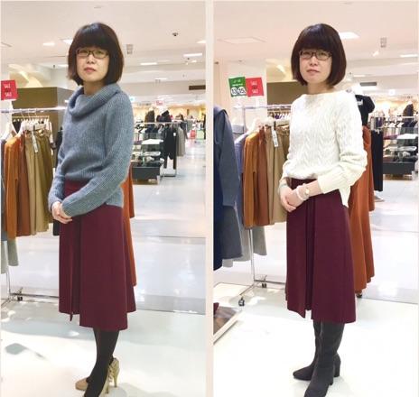 ボルドーのスカートを試着する女性の画像